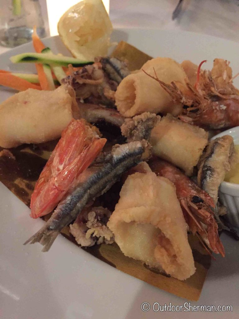 Eating mixed seafood at Trattoria Il Porticciolo